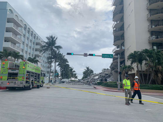 Slide 17 of 34: A huge mound of rubble spills onto the street after the partial collapse of a 12-story condominium building early Thursday, June 24, 2021 in Surfside, Fla. The area around the condo is cordoned off, with about 100 law enforcement officers gathered.