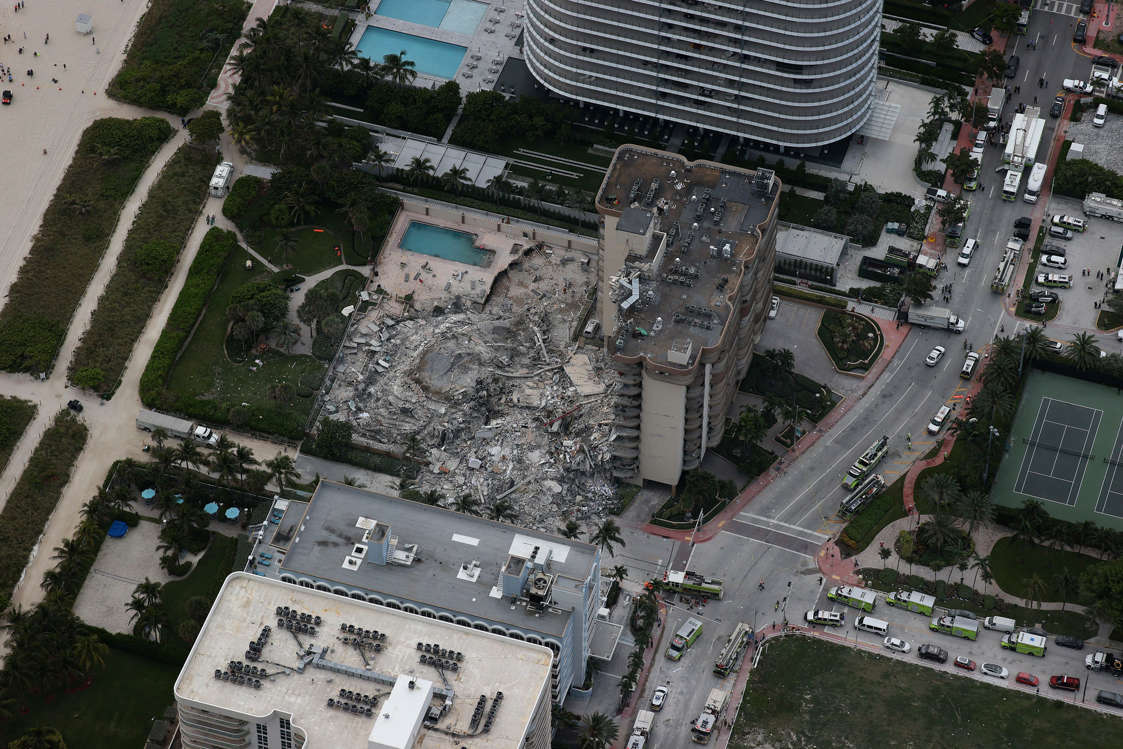 Slide 37 of 58: Search and rescue personnel work in the rubble of the 12-story condo tower that crumbled to the ground after a partial collapse of the building on June 24, 2021 in Surfside, Fla.