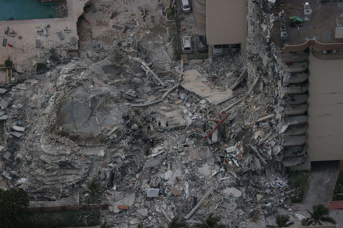 Slide 35 of 58: Search and rescue personnel work in the rubble of the 12-story condo tower that crumbled to the ground during a partially collapse of the building on June 24, 2021 in Surfside, Fla.
