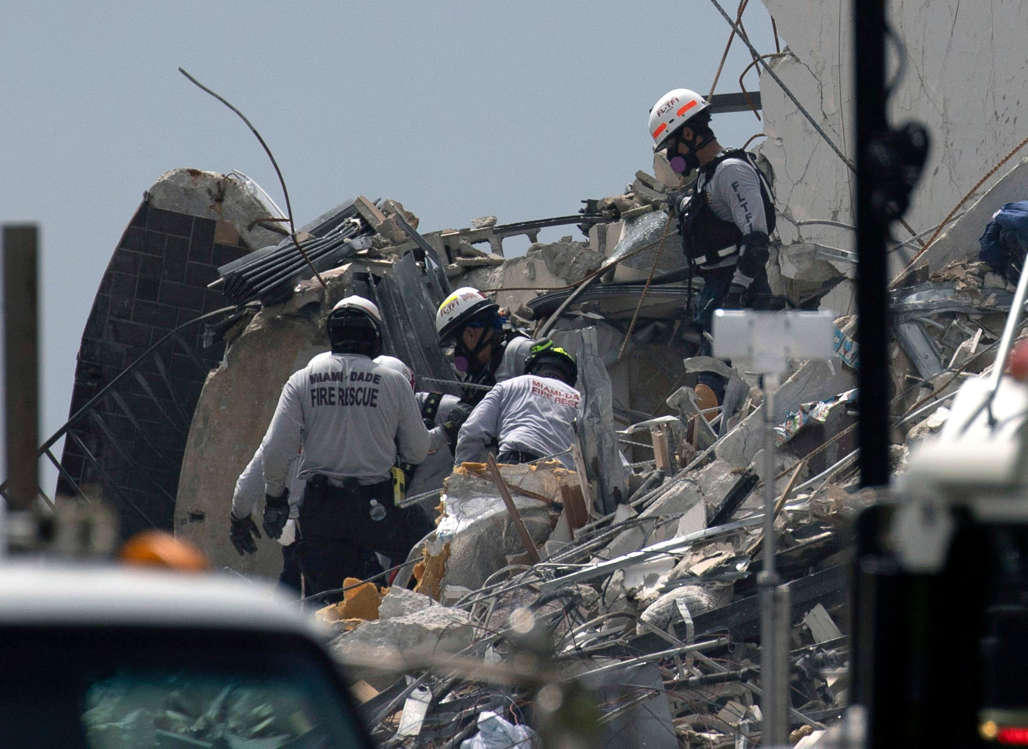 Slide 19 of 58: Miami-Dade Fire Rescue personnel continue search and rescue operations in the partially collapsed 12-story Champlain Towers South condo building on June 25, 2021 in Surfside, Fla.