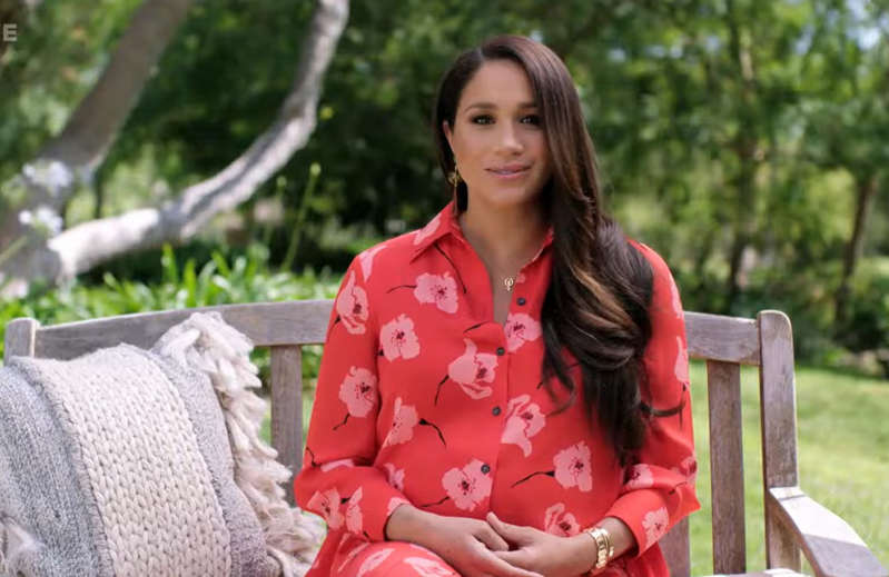Meghan Markle sitting on a bench in a park: The Duchess of Sussex