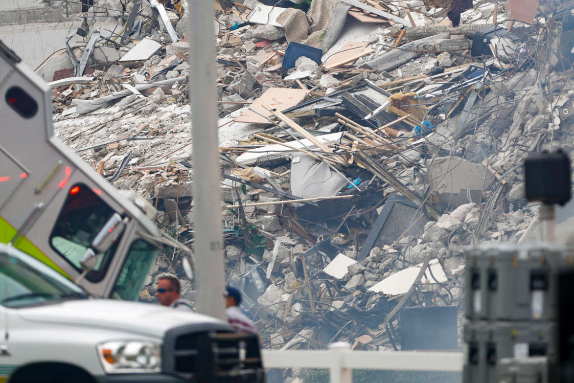 Slide 14 of 58: A view of the 12-story building that partially collapsed Thursday morning seen from the beach in Surfside, Florida.