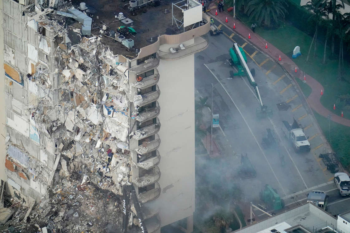 Slide 10 of 58: Rescue workers search in the rubble at the Champlain Towers South Condo, Saturday, June 26, 2021, in Surfside, Fla. The apartment building partially collapsed on Thursday.
