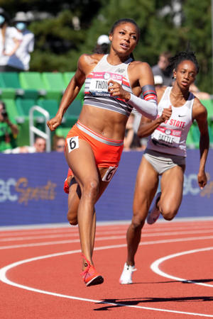 a woman walking on the court: Gabby Thomas ran the best time in the world this year to win the 200-meter final at the U.S. Olympic Trials.