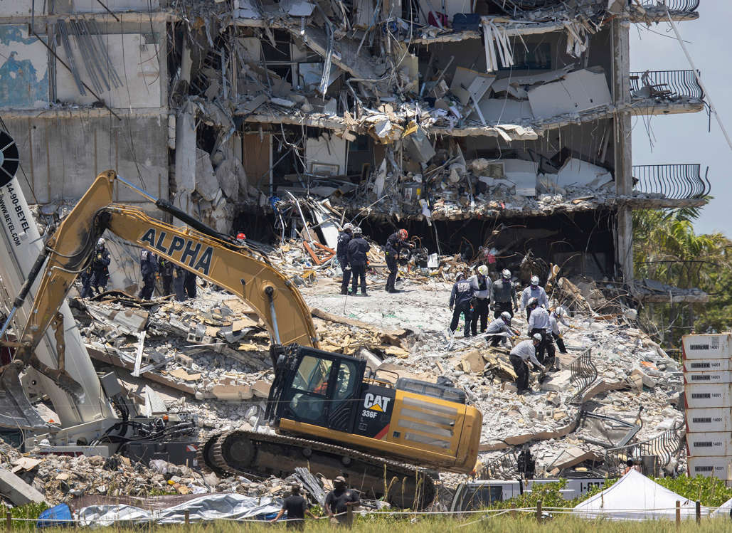 Slide 5 of 58: Search and Rescue teams look for possible survivors in the partially collapsed 12-story Champlain Towers South condo building on June 27, 2021 in Surfside, Florida. Over one hundred people are being reported as missing as the search-and-rescue effort continues.