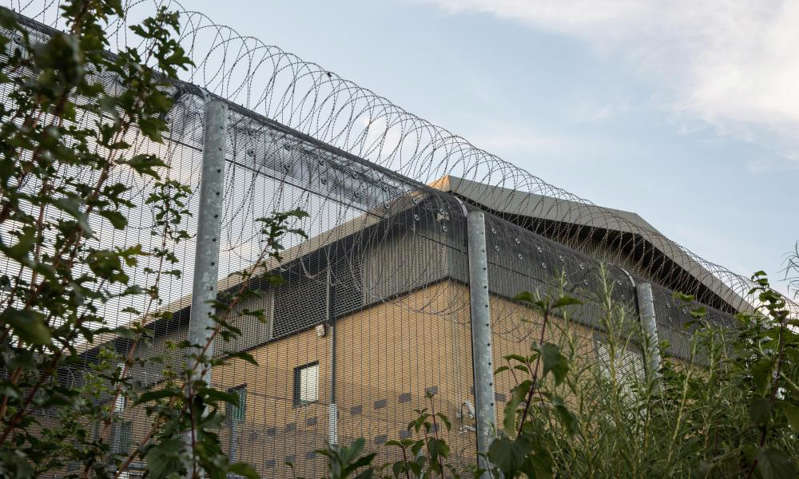 a large brick building: Colnbrook, one of two immigration removal centres at Heathrow airport. Photograph: Mark Kerrison/Alamy