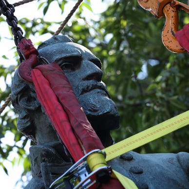 a person hanging on a tree: Charlottesville, VA crowd cheers as Confederate statues removed