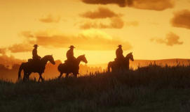 a group of clouds in the sky at sunset: Red Dead Redemption 2 Online Blood Money update news