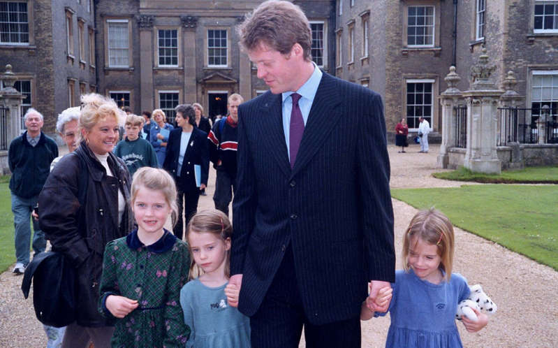 a group of people standing in front of a building: Earl Spencer and his three of his children Kitty, Amelia and Eliza in 1998 - Andrew Shaw