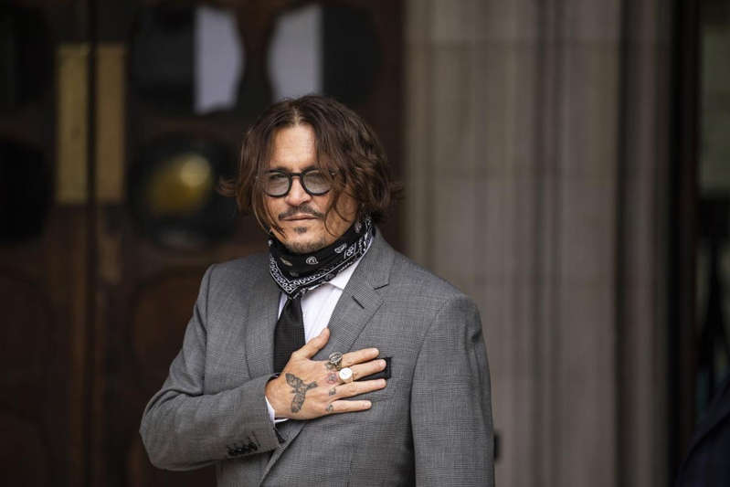 Brad Gerlach wearing a suit and tie: High Court dismissed Johnny Depp's libel action over 'wife beater' claims - Getty