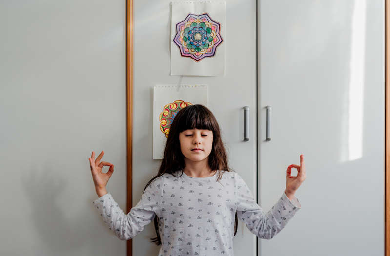 a person standing in front of a mirror posing for the camera: Stocksy-mindfulness-for-kids