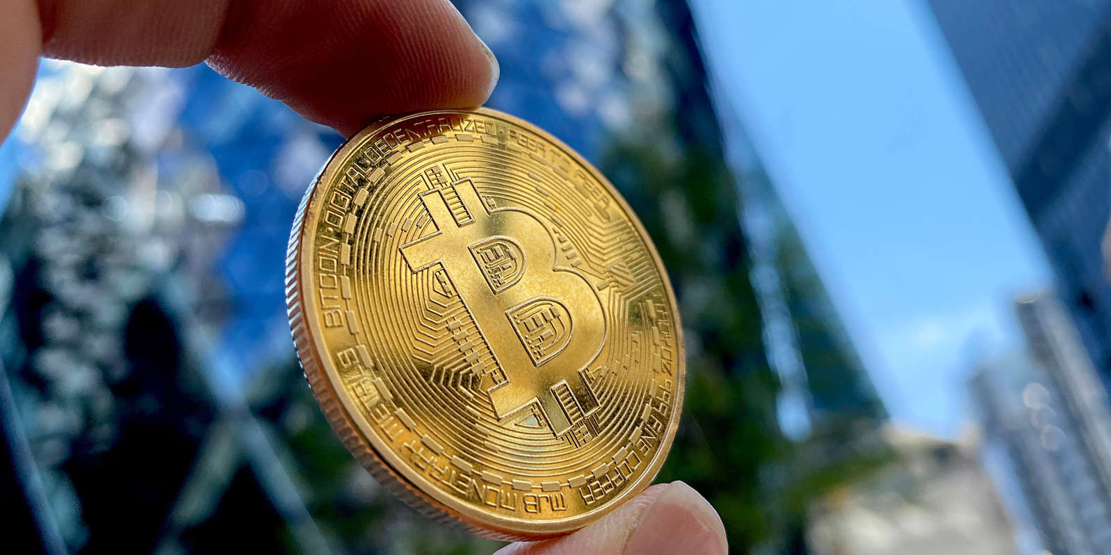 a close up of a hand: Bitcoin. Edward Smith/Getty Images