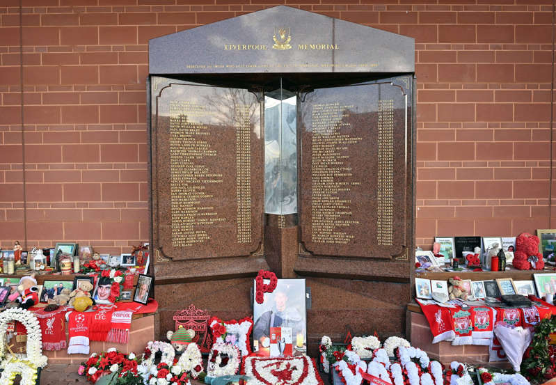 Flowers, shirts and photographs surround the eternal flame of the Hillsborough memorial at Anfield in Liverpool, north west England on April 14, 2021, the eve of the 32nd anniversary of the Hillsborough football stadium disaster in which 96 Liverpool football fans were killed during a FA Cup football tie. (Photo by Paul ELLIS / AFP) (Photo by PAUL ELLIS/AFP via Getty Images)