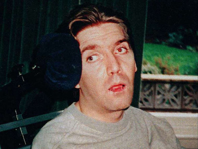 a man looking at the camera: Andrew Devine pictured after emerging from an eight-year vegetative state following the Hillsborough disaster - PA