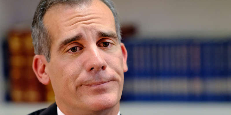 Eric Garcetti wearing a suit and tie smiling and looking at the camera: In this Aug. 16, 2018 file photo, Los Angeles Mayor Eric Garcetti is interviewed by the Associated Press in Los Angeles. ASSOCIATED PRESS