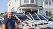 a man standing in front of a building: '30 seconds of fury': LBI homeowner describes scary storm that flipped boat