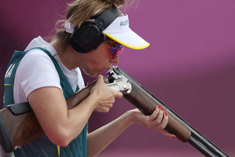 a person holding a gun: Laetisha Scanlan of Team Australia missed out on a shot for a medal.