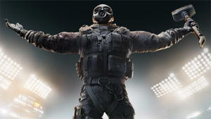a statue of a person: A man carrying a hammer and wearing tactical gear as seen in R6 Siege.