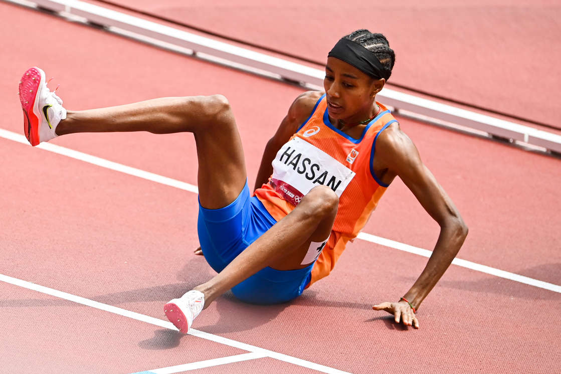 Sifan Hassan on a court with a racket: Sifan Hassan falls while competing in the Women's 1500m Round 1 at the Tokyo Olympics - incredibly the Dutch runner recovered to win.