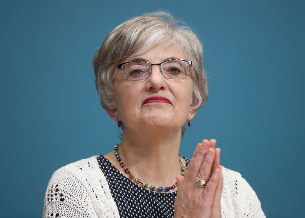 Katherine Zappone wearing glasses: Opposition TDs have compared a private outdoor function at the Merrion Hotel, hosted by Katherine Zappone (Niall Carson/PA)