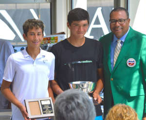 Mark Riley et al. posing for the camera: Ozan Colak, left, holds his 16U feed-in runner-up trophy, as he poses for a photo with feed-in champion Evan Wen and tournament director Mark Riley during the 2019 USTA Boys Nationals on Sunday, Aug. 11 at Kalamazoo College's Stowe Stadium.
