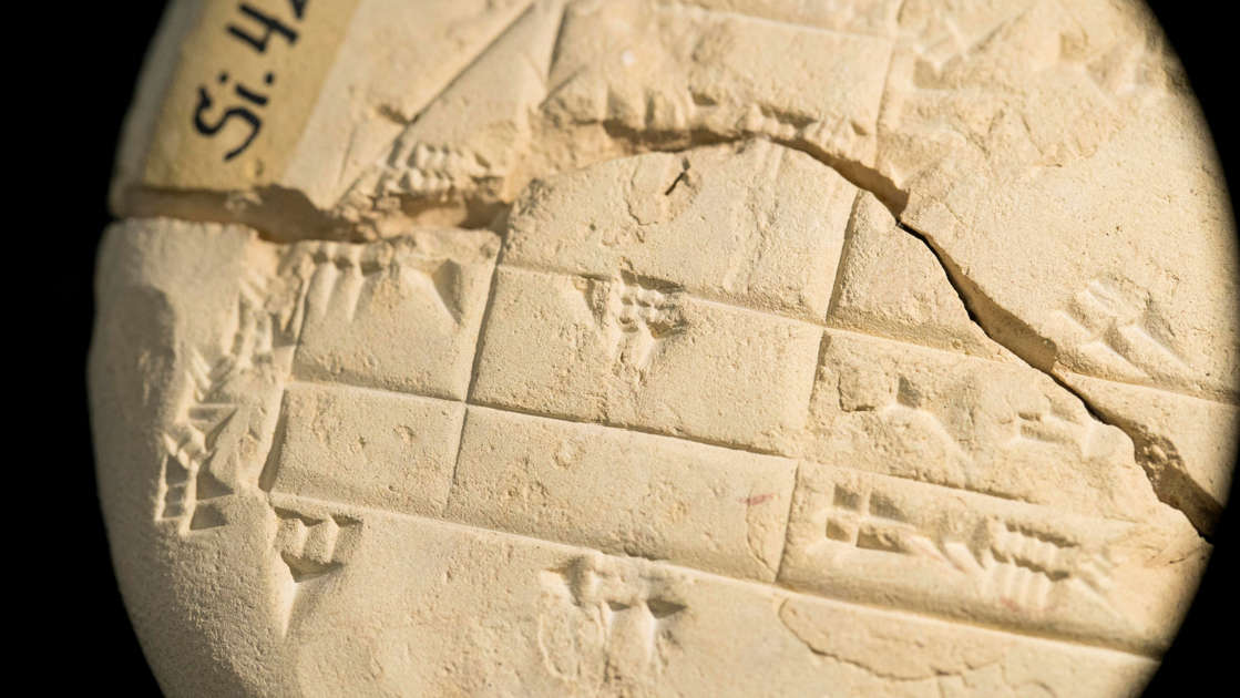 a close up of a stone wall: Si.427 is a hand tablet from 1900-1600 BC, created by an Old Babylonian surveyor. It's made out of clay and the surveyor wrote on it with a stylus.