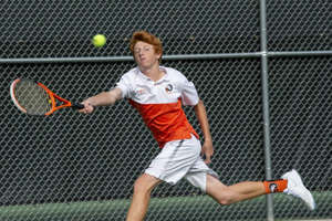 a woman hitting a ball with a racket: Birmingham Brother Rice's J.J. Etterbeek reached to return the ball during the Division 1 Boys Tennis Finals in Midland on Saturday, Oct. 19, 2019.
