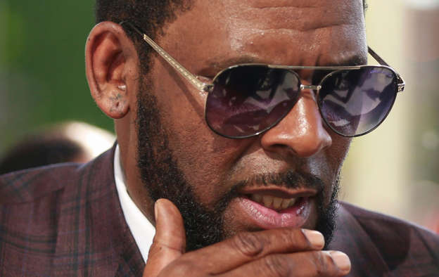 a close up of R. Kelly wearing sunglasses: R. Kelly arriving at the Leighton Criminal Court in Chicago for arraignment, June 26, 2019.