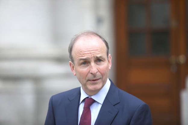 Micheal Martin wearing a suit and tie: Taoiseach Micheal Martin
