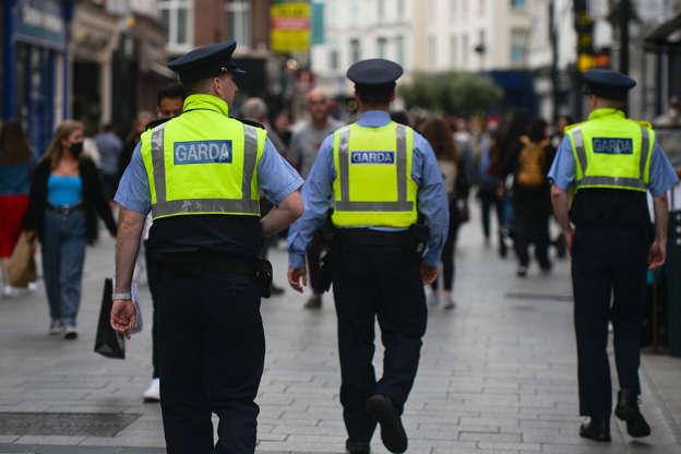 Three Garda officers seen in a busy Grafton Street in Dublin (Photo by Artur Widak/NurPhoto via Getty Images)