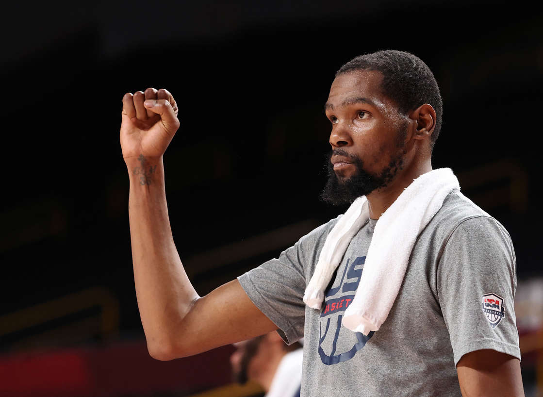 Kevin Durant reacts from the bench as the U.S. used a second-half burst to beat Australia. (Gregory Shamus/Getty Images)