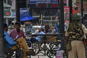 a person standing in front of a store: J&K's Target Killings Trigger Multi-Agency, Inter-State Plan Against Terror, Intel Inputs Increased to Aid Forces
