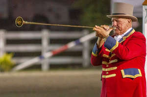 a man wearing a blue uniform holding a baseball bat: The New Jersey State Fair and Sussex County Farm and Horse Show will run from Aug. 7 to 14 at Sussex County Fairgrounds in Frankford.