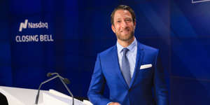 David Portnoy wearing a suit and tie: Barstool Sports founder Dave Portnoy visits the Nasdaq on February 27, 2020 after Penn National Gaming purchased a stake in the media company valuing it at $450 million. Barstool Sports