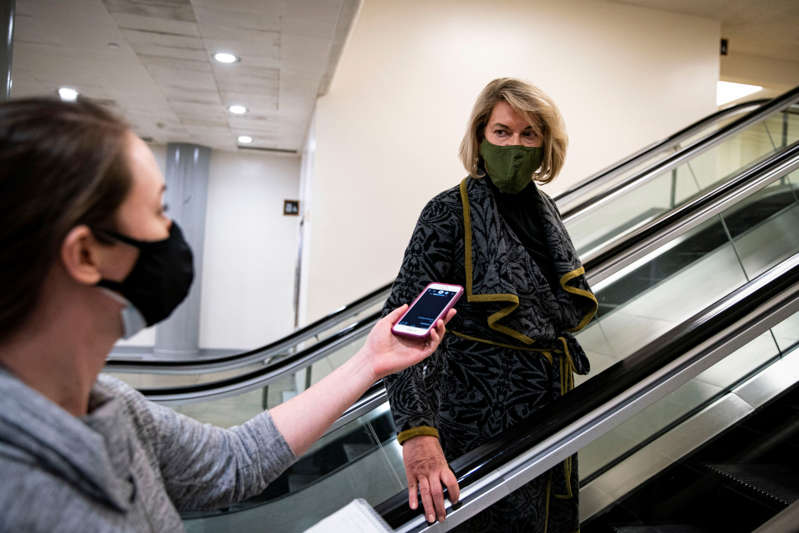 U.S. Senator Cynthia Lummis (R-WY) arrives following a break during the second day of proceedings in the second impeachment trial of former U.S. President Donald Trump on charges of inciting the deadly attack on the U.S. Capitol, on Capitol Hill in Washington, February 10, 2021. REUTERS/Al Drago