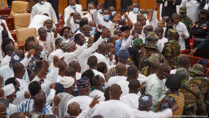 a large crowd of people: Ghanaian soldiers intervene in parliament to quell a clash between opposing parties