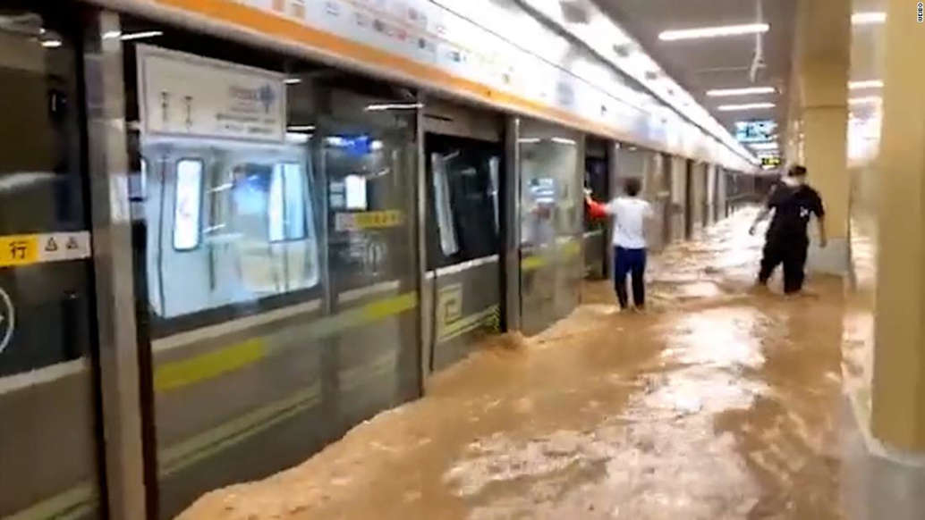a person waiting for a train: A flooded subway station in Zhengzhou, in China's Henan province, after torrential rainfall on July 21.