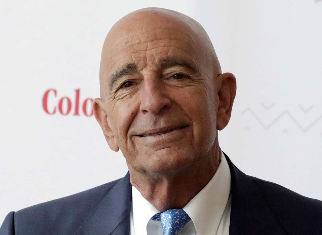 Thomas J. Barrack, Jr. wearing a suit and tie smiling and looking at the camera: Billionaire real estate investor Thomas Barrack