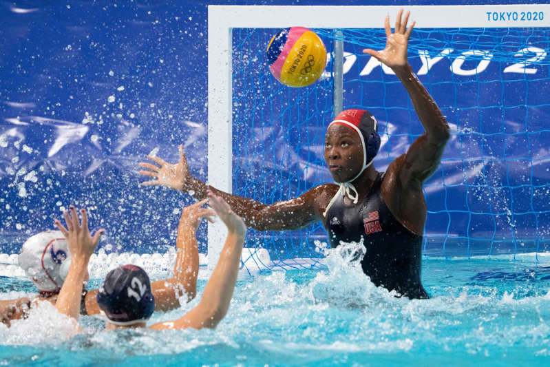 Team USA goalkeeper Ashleigh Johnson (1) makes a save against Team Japan centre forward Miku Koide (6) during the fourth quarter in the preliminary round Group B match during the Tokyo 2020 Olympic Summer Games at Tatsumi Water Polo Centre.