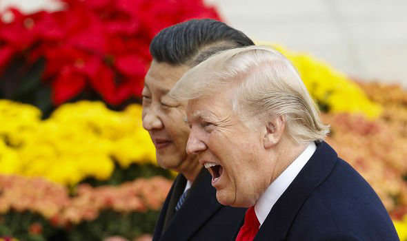 a person wearing a suit and tie talking on a cell phone: China-USA tensions