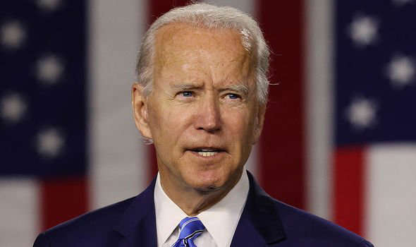 Joe Biden wearing a suit and tie: China-USA tensions