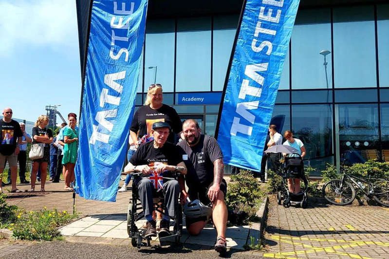 a group of people standing in front of a building: Mike's grandfather Gordon with Rebecca Hambly at Nathan Jenkins sponsored cycle for Mike