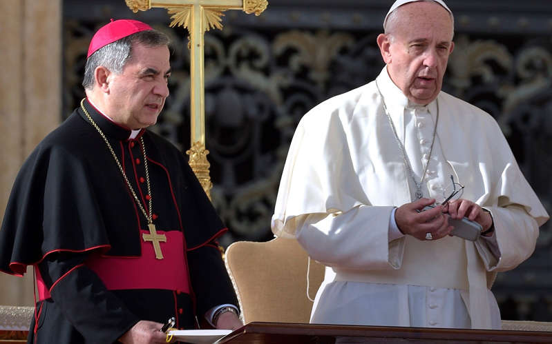 Giovanni Angelo Becciu, Pope Francis are posing for a picture: Cardinal Becciu, pictured here with Pope Francis, is the first cardinal to go on trial. - Stefano Spaziani /Avalon