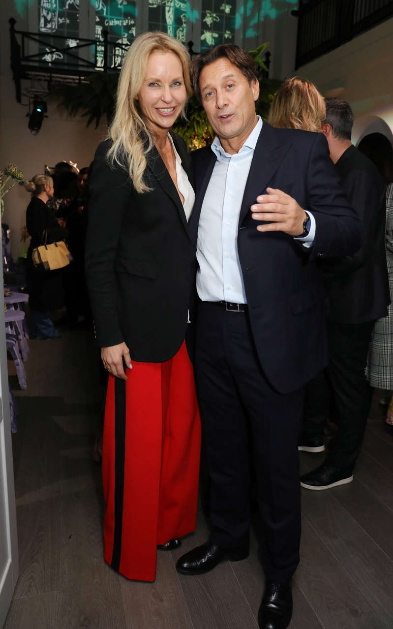 a person standing in front of a group of people posing for the camera: Raffaele Mincione (left), a playboy Italian financier once engaged to the model Heather Mills (not pictured) - David M. Benett /Getty Images Europe