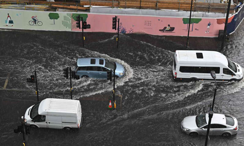 a car covered in snow: Nine Elms, south-west London on Sunday afternoon. Photograph: Justin Tallis/AFP/Getty Images
