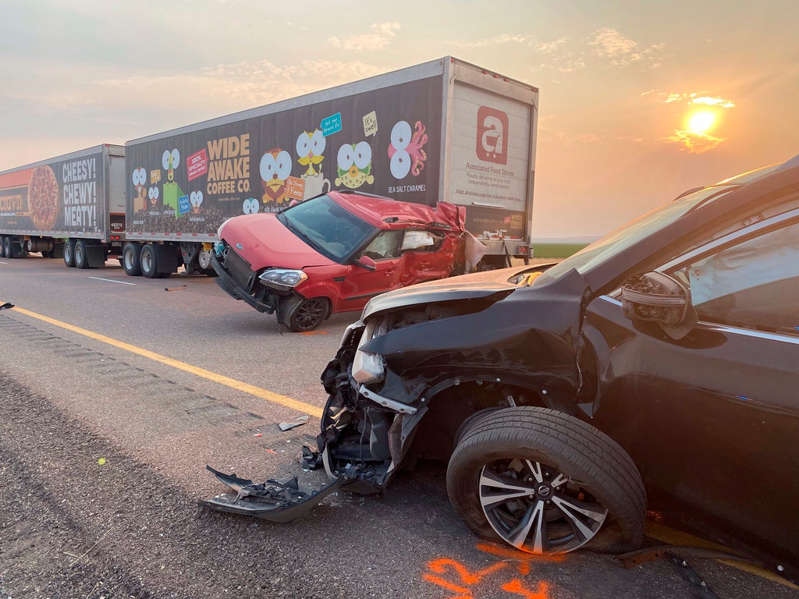 a car parked in a parking lot: The aftermath of the pile-up on I-15 - AP