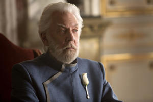 a man wearing a suit and tie: Donald Sutherland as Coriolanus Snow in The Hunger Games