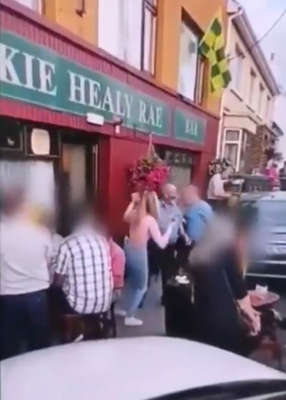 a sign on the side of a building: Pub: Video has emerged of maskless revellers.