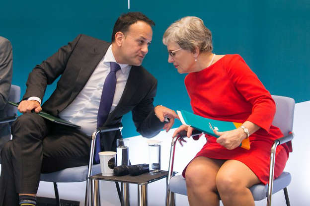 a group of people sitting in a chair: Leo Varadkar and Katherine Zappone