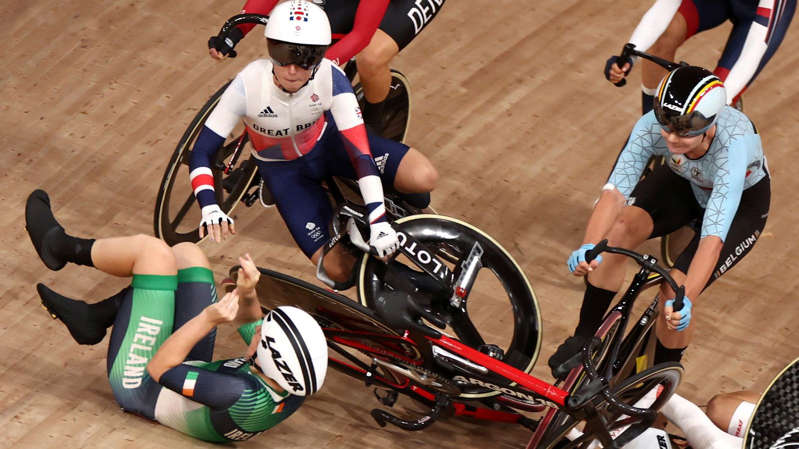 a group of people riding on the back of a bicycle: Laura Kenny had a disappointing start to the women's omnium after she was involved in a crash in the first race